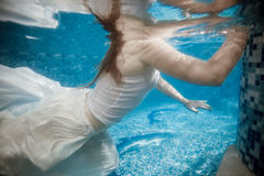 Underwater shot of woman holding on pools edge Royalty Free Stock Photos