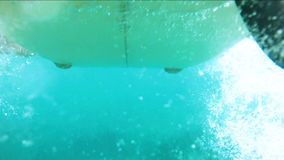 Underwater shots of a Man with his surfboard stock video footage