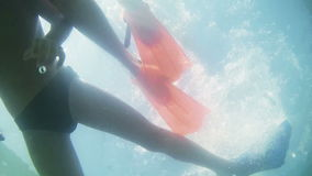 Underwater silhouette of two kids diving in the sea stock footage