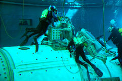 Underwater Spacewalk Training. US astronaut M.Barratt (right) and Russian cosmonaut G.Padalka are training for spacewalks on the exterior of the International Royalty Free Stock Photography