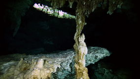 Underwater stalactites in Yucatan Mexican cenote. Underwater stalactites and stalagmites in landscape Mexican Sacred Mayan Cenote. Deep underground clean and stock video footage