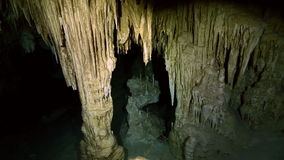Underwater stalagmites in Mexican cenote. Underwater stalactites and stalagmites in landscape Mexican Sacred Mayan Cenote. Deep underground clean and clear stock video footage