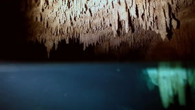 Underwater stalagmites in Mexican cenote. Underwater stalactites and stalagmites in landscape Mexican Sacred Mayan Cenote. Deep underground clean and clear stock footage