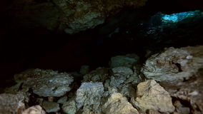 Underwater stalagmites in Mexican cenote. Underwater stalactites and stalagmites in landscape Mexican Sacred Mayan Cenote. Deep underground clean and clear stock video