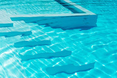Underwater steps in a sparkling blue pool Royalty Free Stock Photo