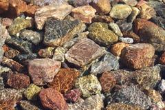 Underwater stones of Mediterranean sea. Stones underwater on sunny day Royalty Free Stock Photo