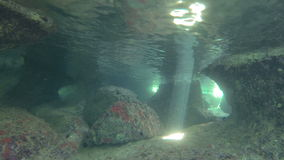 Underwater sun light. Underwater footage of sunrays inside an underwater cave stock video footage