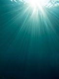 Underwater sun rays. Against the deep blue Royalty Free Stock Image