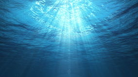 Underwater Sun Rays in the Ocean (Loop). Underwater view with ripples coming towards camera. Sun rays shinning down. Seamless looping video animation stock video
