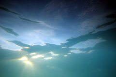 Underwater sunlight 3. Sunlight shining through clear water stock photography