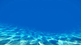 Underwater sunlight reflections. On seabed. Caustics ripple in the blue ocean water stock footage