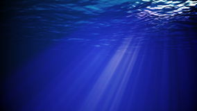 Underwater sunrays. Piercing through the deep water stock footage