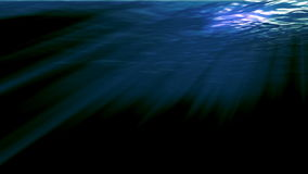 Underwater sunrays. Piercing through the deep water stock video footage