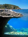Underwater and surface cove. Surface and underwater view of mediterranean cove Royalty Free Stock Photo