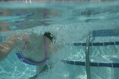 Underwater Swim. A view of a girl swimming underwater Stock Photography