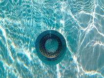 Underwater swimming pool light with sun reflections. Swimming pool light taken underwater with reflections from the surface stock photography