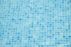 Underwater tiles. Closeup of blue swimming pool tiles Royalty Free Stock Photos