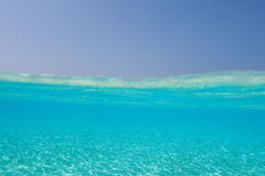Underwater in the tropics. Split shot of the clear water of the Maldives Stock Photo