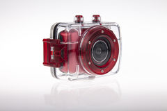 Underwater video camera waterproof case. Underwater red action video camera with plastic waterproof case Stock Photos