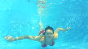 Underwater view as woman swims  Stock Photos