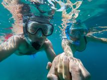 Underwater view of couple snorkeling royalty free stock image