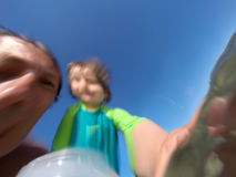 Underwater view of a father and her daughter with distorted face Royalty Free Stock Photos