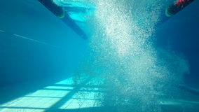 Underwater view of man swimming. And diving in the pool stock video footage