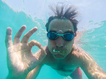 Underwater view of a man swimming in the sea. Underwater view of man swimming in the sea Stock Photos