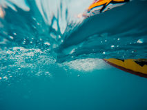Underwater view of a moving inflatable ring that floating in the water Royalty Free Stock Image