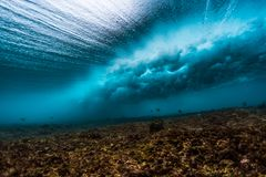 Underwater view of an ocean wave. Breaking over coral reef Stock Images