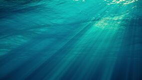 Underwater view with sunbeams shining and creating god rays in the deep sea