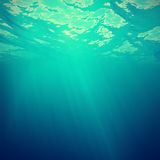 Underwater view of the sea surface with light rays. 3d illustration Stock Photos