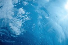 Underwater view of the water surface. Underwater background. Underwater stock image