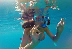 Underwater view of a woman snorkeling in the sea Stock Images