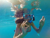 Underwater view of a woman snorkeling in the tropical sea Stock Image