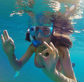 Underwater view of a woman snorkeling in the tropical sea Royalty Free Stock Photos