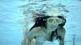 Underwater woman in bikini and goggles stock video footage