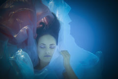 Underwater woman close up portrait in swimming pool Stock Images