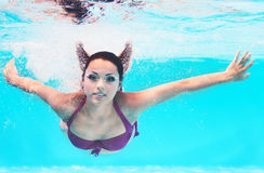 Underwater woman portrait in swimming pool Royalty Free Stock Photos