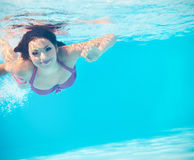 Underwater woman portrait in swimming pool Royalty Free Stock Photography