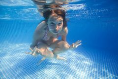Underwater woman in swimming pool Stock Photo