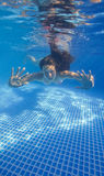 Underwater woman in swimming pool Stock Image