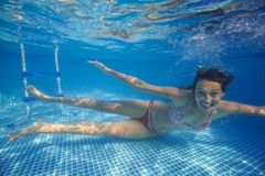 Underwater woman in swimming pool Royalty Free Stock Photos