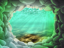The underwater world. Stone cave under water in beams of the sun Royalty Free Stock Photos