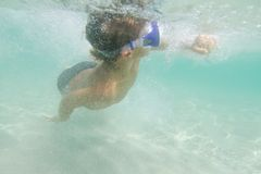 Underwater young boy diving Royalty Free Stock Photography
