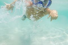 Underwater young boy diving Royalty Free Stock Photos