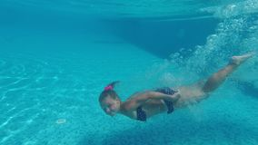 Underwater Young Girl Fun in the Swimming Pool stock footage