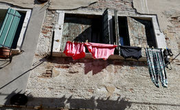Underwear and cloths to dry out of the house Stock Image
