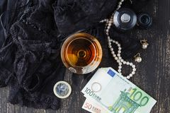 Underwear, cognac and money to symbolize the cost of sex Stock Photography