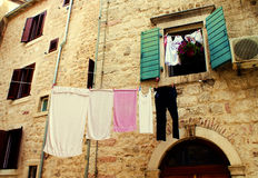 Underwear drying on the narrow streets Stock Photo